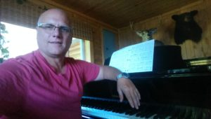 Todd Noordyk at his piano at camp practicing for worship