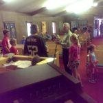 Pastor Jon Hendry talking to and encouraging Gwinn kids